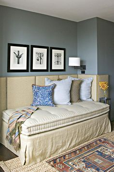 Lots of ideas: DIY upholstered wall panel w/nailhead trim turns any corner of a room into instant guest quarters.  Platform day bed + custom tufted mattress. Great idea!