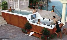 This Hot Tub has two levels, built-in flat screen TV, stereo system and if that wasn't enough a Bar