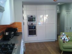 Kitchen Back With Integrated Microwave Double Oven Fridge And Freezer