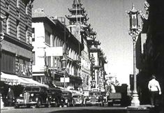 CIRCA 1930s - San Francisco's China Town features a spread of cafes, statues, businesses