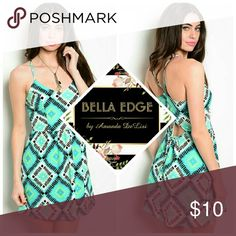 Mint tribal multiprint empire waist dress 95% POLYESTER, 5% SPANDEX. Made in USA. This fun empire waist dress features a beautiful multicolor geometric print all over and a flirty low back cutout detail. Size XS to XL Bella Edge Boutique Dresses