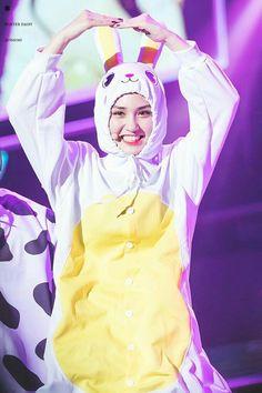 Somi in a rabbit onesie