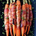 We like our veggies wrapped in bacon Serve these next to a juicy steak or a side dish to a holiday mealthe crowd goes wild Clickable Link in bio httpwwwmantitlementcomrecipesbaconwrappedmapleglazedcarrots