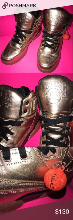 Ewing 33 Hi-rose Gold Sneakers size 11 (44) 100 % authentic rose gold Patrick Ewing 33 sneakers. Patrick Ewing was a basketball player for the New York Knicks. These sneakers have more of a gold than a rose tint to them and have glitter specks. Only worn a few times. US SIZE 11 EUR: 44 1/2 UK: 10  More about this item: The eye-catching Ewing 33 Hi sports a Rose Gold leather upper with Black accent throughout. Finishing off the look is a Gum outsole that features premium glitter speckles…