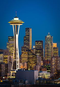 Space Needle Evening, Seattle, Washington was built for the 1962 World's Fair.  It was built to sustain winds ups to 200 mph and earthquakes up to 9.1 magnitude.  It also has 25 lightening rods.  by Inge Johnsson