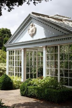 Stunning English greenhouse on the grounds of The Courts garden near Bradford on Avon in the village called Holt ...