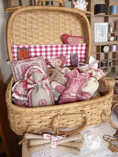 full of sewing notions~so pretyy in red an white