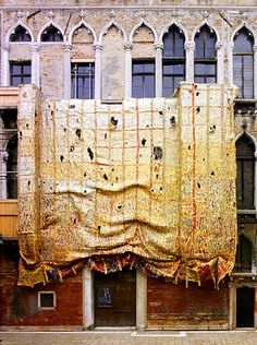 """Glamour from Garbage.  """"Fresh and Fading Memories"""", by El Anatsui. Amazing shimmering textile hanging, made of bottle tops and other trash, hung on the facade of Palazzo Fortuny in Venice, Venice Biennale 2007."""