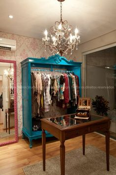 Love this wardrobe with doors removed and painted a turquoise color! Extra closet space idea.