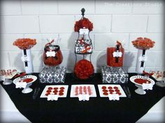 Black, red and white candy buffet as wedding favors