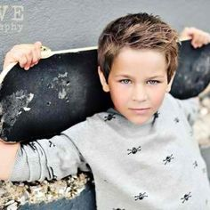 Cute little boy hair cut and pose for a picture