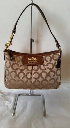 13.Coach Madison Op Art Top Handle Pouch. Starting at $10