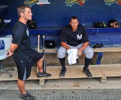 New York Yankees third baseman Alex Rodriguez, right, sits in the dugout takling with Yankee athletic trainer Mike Wickland