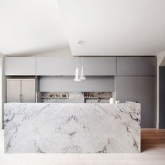 Marble island in modern kitchen with chrome details