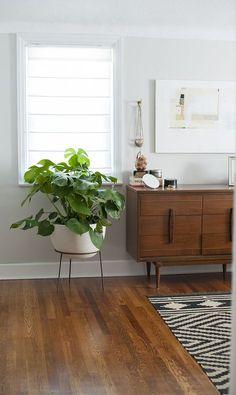 Mid century dresser. Love the legs on it.  A Modernized Charmer For Creatives in Pennsylvania   Design*Sponge