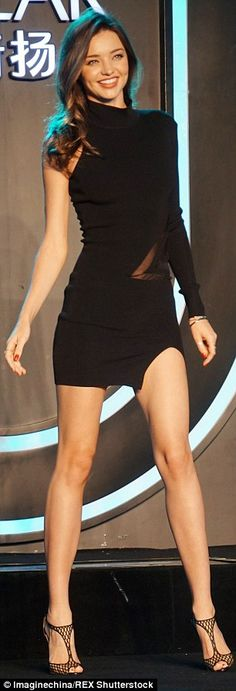 Supermodel body: As well as showing off her legs, the little black dress gave a glimpse of...
