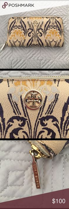 TORY BURCH ROBINSON ZIPPY WALLET Beautiful, Gently Used, TORY BURCH ROBINSON ZIPPY WALLET. It is the large style with plenty of space for cards, cash, coins, etc. All zippers work great. It is gold with navy/purple accents. Minimal signs of wear..mostly around zipper area and hardware has tarnished a little...not noticeable. See pics for details. Tory Burch Bags Wallets