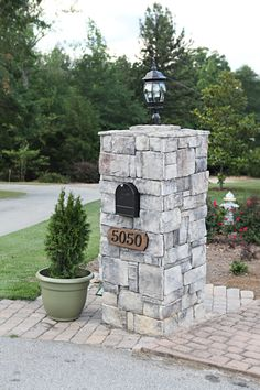 Love the stone pillar with the light fixture, address and built-in mailbox. (Bower Power)