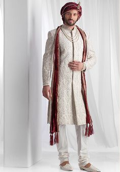 Rawsilk fabric with resham work and delicate pearl embroidery. Turban and stole are not included