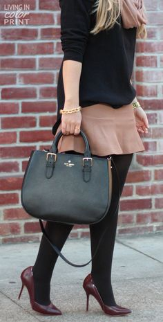 Camel Trumpet Skirt highlighted by black sweater, bag, and tights.