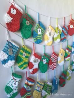 Free pattern for a crocheted stocking advent calendar. 24 mini stocking are filled with treats to count down the day until Christmas, lots of design variations are included.
