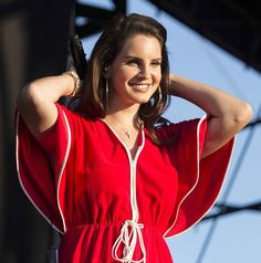 lana del rey looking like a goddess in her red dress while performing