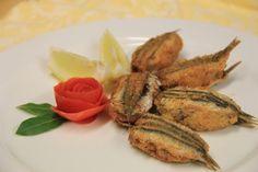 Acciughe ripiene. Scopri in FoodInItaly tutte le ricette regionali della tradizione italiana.