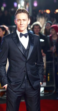 Hands down the best dressed man around. That suit is flawless.