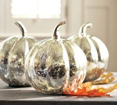 ake Dollar Tree pumpkins and paint them white, then apply Krylon Looking Glass paint to get the effect of mercury glass and not have to worry about them getting broken.