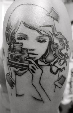 """said by the wearer.... """"This is my 7th tattoo I got 2 days ago. It's an Audrey Kawasaki piece that I had stumbled upon and instantly fell in love. It includes my love for her artwork as well as photography, which has always been a hobby of mine.""""    Done by Jess V @ Sacred Tattoos in New York, NY."""