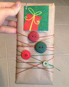 Homemade wrapping using brown paper, button & string. #Christmas #wrapping #button #buttons #string #xmas