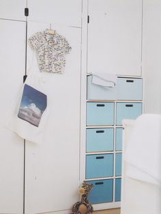Built-In Cabinets and Blue Ombre Drawers - #ombre #storage. LOVE this!