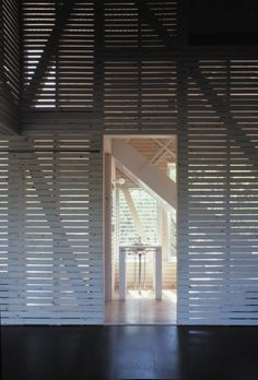 leaving spaces within the woodwork to conceal/reveal the space by allowing light in.