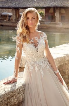 Beautiful lace sequins down the back and the illusion sleeves of this gown.