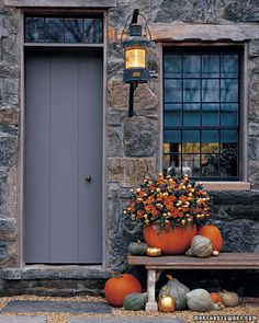 When it comes to decorating the front door for Halloween I definitely prefer a simple treatment. Pumpkins are a must! Fall flowers or a few other select Halloween props look nice. I think it helps to repeat the decorative item(s). Pumpkin Vase, Pumpkin Flower, Pumpkin Planter, Pumpkin Bouquet, Large Pumpkin, Pumpkin Display, Gold Pumpkin, Pumpkin Carvings, Diy Pumpkin