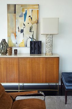Detail of David Scott's Manhattan Living Room with McCobb credenza and Gibbings ottoman - great color combo - warm and cool.