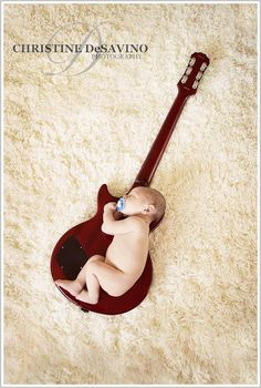 another baby with guitar. Cute for rock themed baby room or if daddy/mommy is a guitar player