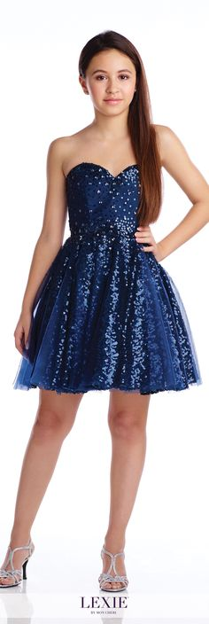 Lexie - TW21609 - Strapless tulle and sequin lace above-the knee A-line dress, sweetheart neckline trimmed with beading, full gathered tulle over sequin circular skirt. Removable straps included.Sizes: 7-16Colors:Navy Blue, Hot Pink