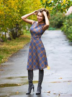 Woolen Dress Scotland. Blue-yellow plaid fabric would keep up your spirits in the fall season :)  - Asymmetric hemline makes the dress stretchy and creates a perfect fit; - Classic knee-length; - Elegant cut-out neckline; - Hidden zipper in the side seams; - Playful frills.  Fabric Composition: 70% viscose, 30% wool.