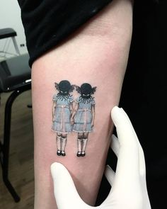 The Shining inspired tattoo on the right inner forearm.
