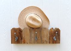 Fence Top three hook rack made from reclaimed wood pickets. $36.00, via Etsy.