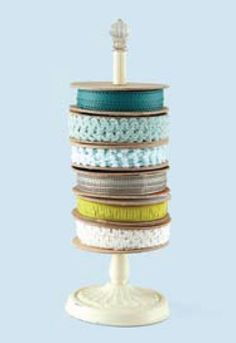 Display ribbon spools on a paper towel holder. Would also work great for washi tape. From Creating Keepsakes magazine.