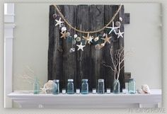 summer decorating ideas, home decor, patriotic decor ideas, seasonal holiday d cor, wreaths, Summer Mantel with shells starfish and mason jars