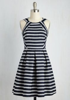 Finding this navy dress is being showered with compliments out on the 'high-fashion seas'? We had a hunch! Designed with textured, white-striped fabric, a boldly pleated skirt, and a retro silhouette, this A-line makes enough waves to reach the shore!