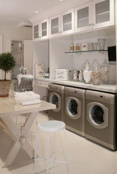 Laundry Day - notice glass jars holding clothes pins and laundry detergent also antique laundry basket and fold down ironing board