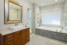 maple cabinets, stainless pulls, light counter white sink and mother of pearl Bathroom Renos, Bathroom Renovations, Bathroom Interior, Modern Bathroom, Master Bathroom, Home Remodeling, Bad Inspiration, Bathroom Inspiration, Tile Tub Surround