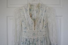 I had several Gunny Sax dresses in the late 70s and I LOVED them.  I always felt so feminine and pretty when wearing them.  1970's Jessica McClintock Gunne Sax Dress size 9 Cream with Blue Flowers. $69.00, via Etsy.