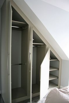 Our fitted furniture is constructed to fit angled ceilings. We design and build the right fitted furniture for your loft conversion. Attic Bedroom Ideas Angled Ceilings, Slanted Ceiling Bedroom, Attic Bedroom Storage, Attic Master Bedroom, Attic Bedroom Designs, Loft Storage, Upstairs Bedroom, Attic Rooms, Closet Bedroom
