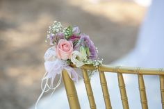 Decorate the ceremony chairs with a small colorful bouquet!!  #wedding #flower #decoration #weddingingreece #mythosweddings #ithaka