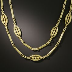 Measuring 63 inches long (that's just over 5 feet!), this delightful neckchain from early-20th-century France, rendered in rich 18K yellow gold, is composed of graceful navette shape links embossed with neoclassical acanthus leaves and centered with spirals, interspersed with pairs of watch chain style links. Wear it doubled, tripled, of full length. Victorian Jewelry, Antique Jewelry, Gold Jewelry, Jewellery, Chain Links, Acanthus, Cartier, Chains, Shopping Bag